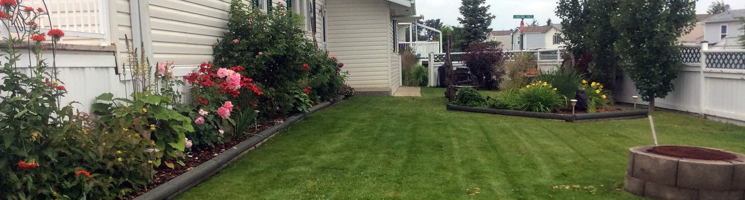 Clean flowerbeds with mowed lawn