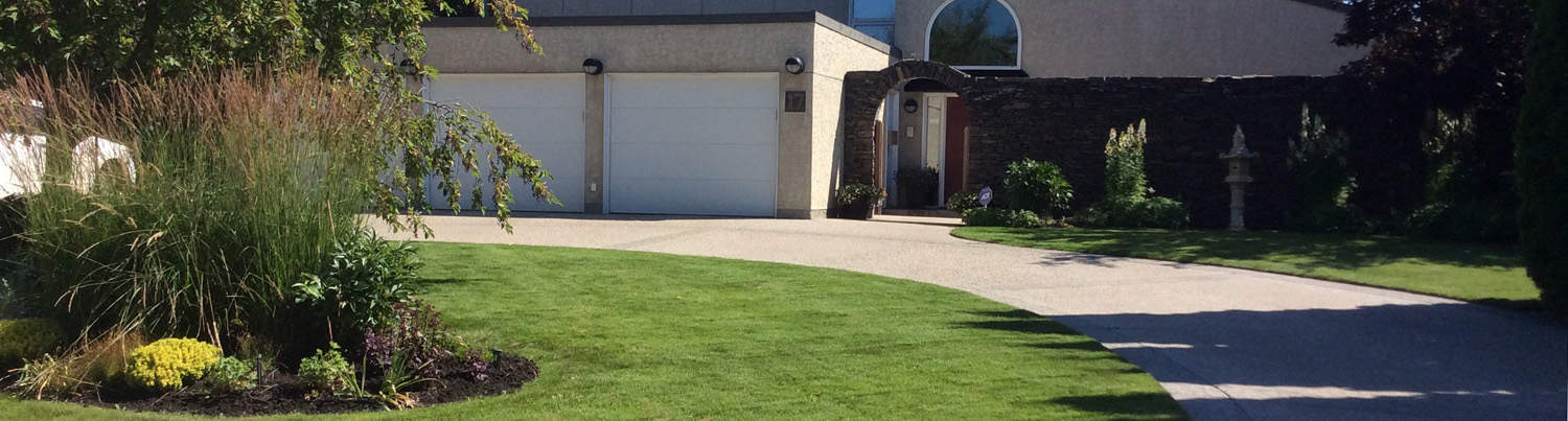Manicured home entrance, trimmed grass edges