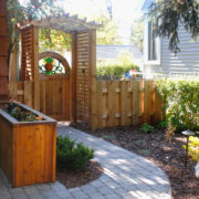 Custom gate with inset stained glass